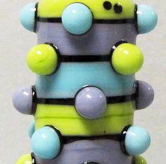 Turple & Green Bubble Dot BarrelHandmade by BeadygirlBeads on Etsy