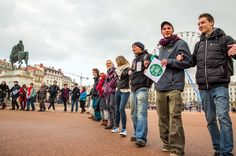 Climate marches were canceled in France as part of the state of emergency after the Nov. 13 attacks in Paris. However, several hundred people formed a human chain despite the prohibition on Nov. 2015 in Lyon, France. People Around The World, Around The Worlds, Environmental Ethics, Environmentalism, Powerful Images, Lyon France, Paris Photos, Global Warming, Ecology