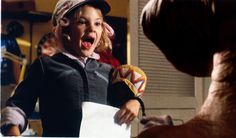 A young Drew Barrymore meets E.T. for the first time. They both scream!!