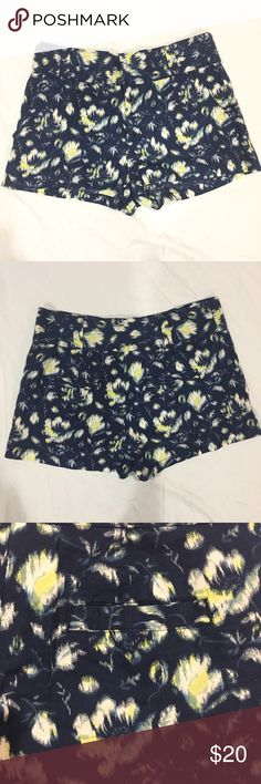 """UO Kimchi Blue floral shorts Blue fabric shorts with white, yellow, and green floral print. Has open front pockets, and faux back pockets. Length: 12"""", inseam: 2"""", rise: 11"""", waist: 16"""" across. 60% linen and 40% cotton. In great condition. Feel free to make me a reasonable offer 💕 Urban Outfitters Shorts"""