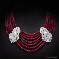 Beauté Eternelle necklace, Palais de la chance collection  White gold, diamonds, ruby beads and two EVVS2 round diamonds of 2,31 and 2,33 carats. The Beauté Eternelle necklace from the High Jewelry collection Palais de la chance inspired by the panchang motif is composed of a cascade of 665 ruby beads from Madagascar, giving rich volume to the piece. Discover the unique skills applied by Van Cleef