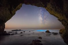 Bioluminescence glowing under the Milky Way from a huge Malibu sea cave last night. Bucket list shot doesn't start to describe it! : space