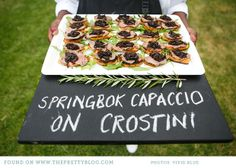 Springbok capaccio on crostini Wedding Reception Canapes, Wedding Catering, Party Food Bars, Party Food And Drinks, Catering Display, Catering Food, Catering Events, Catering Ideas, Safari Wedding