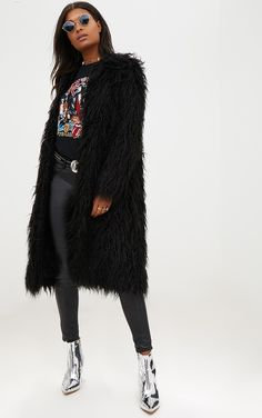 Black Shaggy Longline Faux Fur Coat Girl this shaggy longline faux fur coat is a must have for the colder months, style up or down whatever the occasion and wrap up in style. Shaggy Fur Coat, Fur Coat Outfit, Black Faux Fur Coat, Glamorous Outfits, Mode Mantel, Fur Jacket, Coats For Women, How To Wear, Women's Fashion