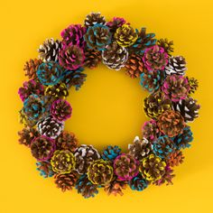 DIY Colorful Pine Cone Fall Wreath - Sarah Hearts : Add color to your fall and holiday decor by making this paint dipped pine cone wreath! Learn how to make a colorful pine cone fall wreath that is perfect for both Thanksgiving and Christmas. Wreath Crafts, Diy Wreath, Fall Crafts, Christmas Crafts, Decor Crafts, Diy Crafts, Wreath Making, Ornament Wreath, Fabric Crafts
