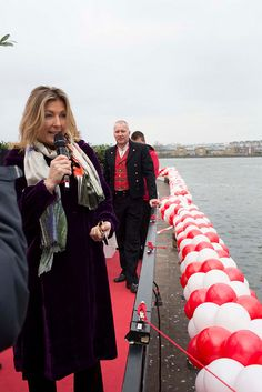 """Lady Fiona Carnarvon, Godmother of Viking Skadi, addresses the guests at the Viking River Cruises christening ceremony. Lady Fiona Carnarvon is the wife of George Herbert, 8th Earl of Carnarvon. She recently authored the New York Times Bestseller """"Lady Almina and the Real Downton Abbey: The Lost Legacy of Highclere."""""""