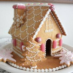 """This lovely Gingerbread House was made by a friend's Daughter-in-Law, Noriko and recently featured in the Japanese magazine """"Very"""".  Just Beautiful."""