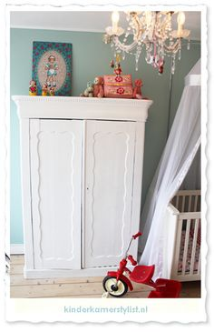 collection of vintage accessories give color and style in the nursery