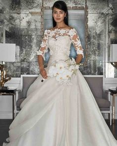 Romona Keveza Fall 2017 Wedding Dress Collection | Martha Stewart Weddings – Pearl ball gown made of silk organza features a draped bodice with sweetheart neckline. Shown with an off-the-shoulder overblouse made of appliqué flowers and beaded lace.