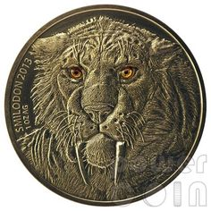 From Africa the prehistoric SMILODON - often called a saber-toothed cat or incorrectly a saber-toothed tiger.  The special features of this 2013, 1 oz silver coin are its Antique Finish and Real Eye Effect.
