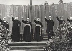 Priests giving the Hitler salute at a Catholic youth rally in the…
