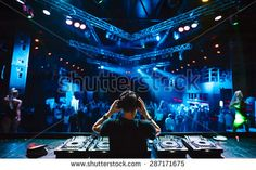 stock-photo-dj-with-headphones-at-night-club-party-under-the-blue-light-and-people-crowd-in-background-287171675.jpg (450×301)