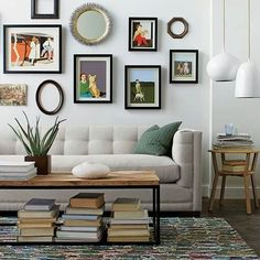 Nice clean sofa with salon style art wall, coffee table and book storage. Great small space living room. #LivingRoomSofaarrangementsmallspaces