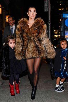 Kourtney Kardashian wearing Balenciaga Boots and Rta Gustave Fur Jacket