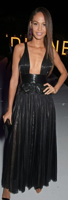 Joan Smalls certainly brought the edge in a shiny black pleated Givenchy Haute Couture dress complete with a wide-plunging neckline. But the most striking part of her look had to be those sparkling pink hoop earrings!