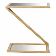 """Display a vase of fresh flowers or rest your evening cocktail on this chic accent table, featuring a gold-finished base and rectangular mirrored top.   Product: Side tableConstruction Material: Iron and mirrored glassColor: GoldFeatures:Contemporary appealDimensions: 21"""" H x 19.7"""" W x 13.7"""" D"""
