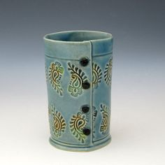 """The print, glaze, """"buttons"""" and shape are all amazing.  Pretty sure this is slab built."""