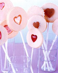 confectionery valentines: sugar-cookie lollipops embedded with candy hearts or layered into frosted sandwiches
