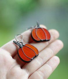 Pumpkin earrings made from bright orange stained glass in Tiffany technique.  A beautiful little pumpkins to Fall season!  #artkvarta #jewelry #earrings #fall #autumn #orange #vegetables #halloween #decor #unique