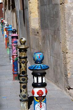Painted bollards in Pilon Street (aka Carrer de Compte) in Tarragona. #streetart #urbanart