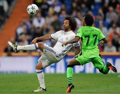 Marcelo of Real Madrid CF controls the ball beside Gelson Martins of Sporting Clube de Portugal during the UEFA Champions League match between Real Madrid CF and Sporting Clube de Portugal at Estadio Santiago Bernabéu on September 14, 2016 in Madrid, Spain. (Sept. 13, 2016 - Source: Denis Doyle/Getty Images Europe)