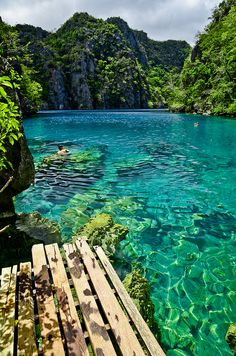 Kayangan Lake - Coron islands, Palawan, Philippines The enchanting Kayangan Lake, which is located in the interior of Coron Island, is said to be the cleanest lake in the Philippines. To get to Kayangan Lake, tourists have to climb a steep mountain trail. Photo by 13thFool via Flickr