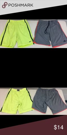 2 Pair of Boys (M) Nike/Adidas Basketball Shorts. Nike shorts is highlighted Yellow and Black with Nike on back of waist band and Black Nike Swoosh logo at the bottom of one leg. Missing drawstring. Adidas Climalite Gray and Orange with drawstring and Adidas on the bottom of one leg. Nike/Adidas Bottoms Shorts