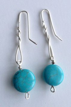 silver wire wrapped earrings with turquoise beads  http://www.etsy.com/shop/ScissorsAndPearls