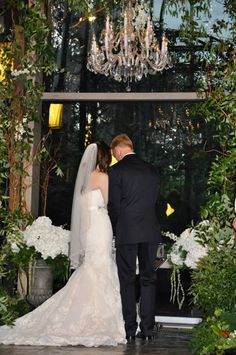 beautiful couple..under the chandelier