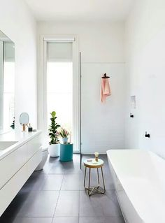 We've collected 50 gorgeous pictures to inspire your minimalist home decor — including ideas for your living room, office, dining room, kitchen, and bathroom. Laundry In Bathroom, Bathroom Renos, Bathroom Layout, Bathroom Interior, Bathroom Ideas, Bathroom Plants, Bathroom Organization, Bathroom Pink, Bathroom Stools