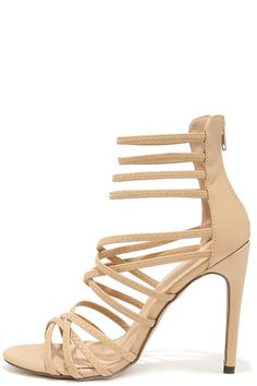 """With so many parties to attend, you need a chic go-to like the Invites Queen Nude Caged Heels! These pretty dress sandals have crisscrossing vegan leather straps over the toe, and stretchy elastic straps completing the caged upper. 3.5"""""""" heel zipper. #fashion #style #streetstyles #popsugar #wachabuy #apparel"""
