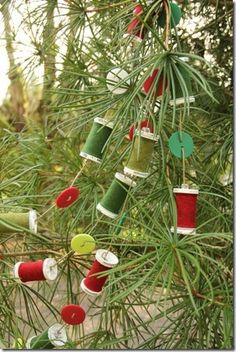 Thread Spool and Button Garland. This is a great tutorial on how to make this. The thread on the spools aren't even real. Could do this for any room, not just Christmas.