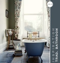 Just read and relax in this fabulous tub. I'd be changing out the curtains, though. LOVE the tub and the wood floor.