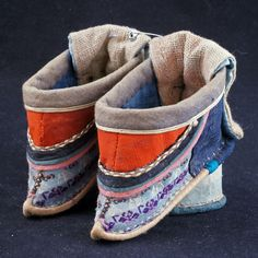 Chinese Qing very tiny silk bound feet shoes with raised heels late 19th century