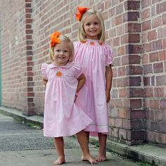 Your little girls will be the talk of the fall with these adorable pink pumpkin smocked dresses! #smocked #pumpkins #pink #fall #smockedauctions #sakids