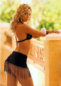 Stacy Keibler - Standing pretty blonde in skirt with tassels.