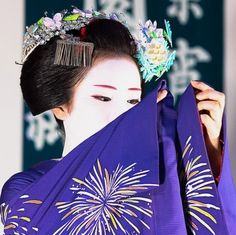 A senior maiko during the month of July, fireworks pattern on kimono