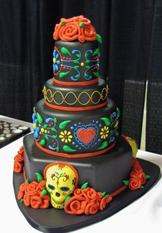 https://flic.kr/p/9ssELg | Day of the Dead - without flash (by Ashlee Trotter) | Division: Adult Professional Category: Special Occasion/Novelty Tiered Cakes 1st Place Title: Day of the Dead by Ashlee Trotter Business Name: Ruth's Sweete Justice, Oklahoma City (the colors really are brighter than this) Capital Confectioners' 7th Annual 2011 That Takes the Cake Sugar Art Show & Cake Competition