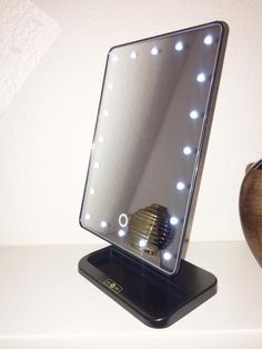 This travel vanity mirror is perfect for those on the go or those that just need some up close and personal makeup touches. No electrical outlet needed. Colors: Black or White Batteries are Diy Makeup Vanity, Lighted Vanity Mirror, Makeup Vanity Mirror, Makeup Mirror With Lights, Led Mirror, Make Up Mirror, Makeup Bar, Mirrors For Makeup, Dresser Vanity