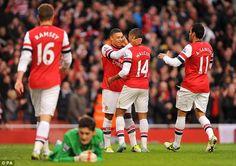 Red hot: Theo Walcott scored the final goal as Hugo Lloris shipped five