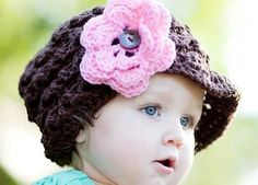 Crochet baby girl hats are beautiful accessories that most mothers love to buy for their girls. They are suitable for babies, including newborn baby, toddlers, young kids and even teens. They come in different designs with flowers, balls, side straps, side flowers, etc. There are also colorful hats without any embroidery or embellishments for kids, to allow much comfort. Crochet baby girl hats are made of different types of yarn, such as wool, cashmere