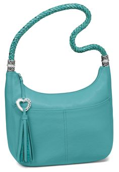 "One of our best loved handbags, the Barbados Ziptop Hobo (now in ""Sea"" blue) is a favorite for its soft-on-the-shoulder strap and roomy interior. Pockets keep whatnots organized and the tassel adds panache!"