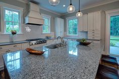 The granite in my new kitchen.  A little busy for me, but I only had a few choices.  Funny, though, I had these same pendant lights pinned already and want to do subway tile and white cabinets. :-)   Reed Residence - Rose Dhu Creek Plantation - Kitchen - Other Metro - Center Point Cabinets