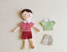 """paper dolls"" made out of felt and a ""house"" to keep them and the clothes in. Great idea"