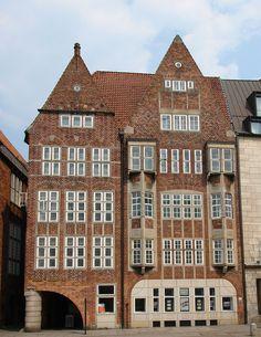 Atlantis House on Bremen's Böttcherstraße 1931 ~ Bernhardt Hoetger. Facade rebuilt in 1965 due to war damage by Ewald Matare.