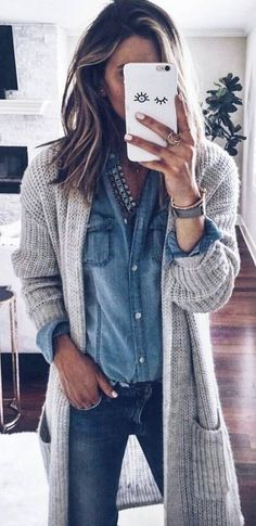 Light gray cardigan over chambray shirt and navy jeans.