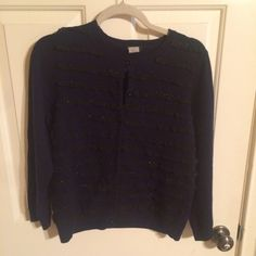 J.Crew cardigan J.Crew button up cardigan long sleeve with black buttons. This is a navy sweater with black ruffle stripes with little beads on it. This item is pre owned but in good condition! Super discounted price!! 100 % merino wool J. Crew Sweaters Cardigans