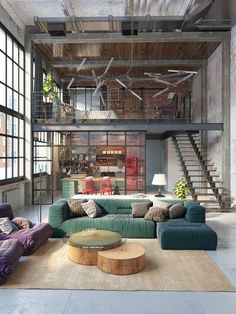 There's something so poetic in taking an old factory and turning it into a modern home | industrial loft with huge windows and high ceilings | colourful Togo sofas make an interesting focal point |