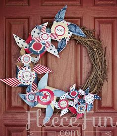 #DIY 4th of July Wreath @Leslie Fox ... Reminds me of the scrapbook bows, kind of. Got any paper we could use?? ;D
