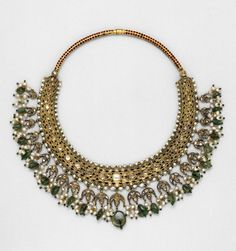 Some British women collected traditional jewellery, and north Indian jewellery became fashionable among British women living in India in the 1880s. The front of the necklace is set with diamonds, but the back is enamelled with flower and leaf patterns in translucent red and green on an opaque white ground.